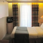 Outside Deluxe cabin with balcony (B): double bed and upper bunk